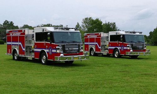 Two Apopka Fire Trucks in grassy area