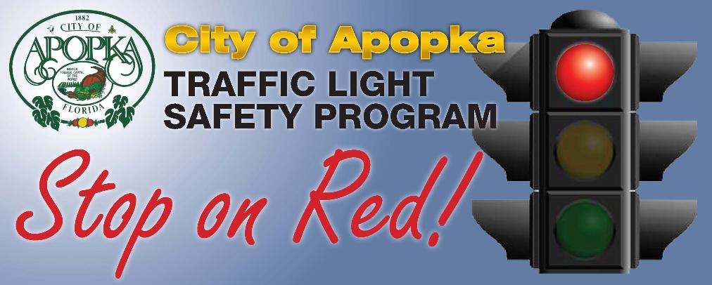 Banner with Stoplight, City of Apopka Logo, reading Traffic Light Safety Program Stop on Red!