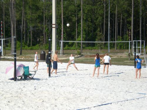 Teens playing volleyball.